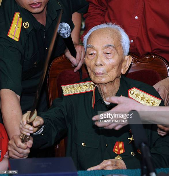 Vietnamese legendary retired general Vo Nguyen Giap receives a bronze commander sword offered by Vietnamese historians during a private meeting held...