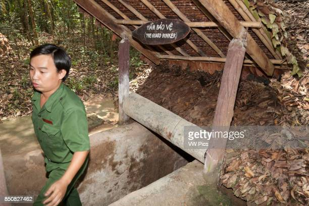 Vietnamese man exiting a Cu Chi tunnel at Ben Dinh Cu Chi near Ho Chi Minh City Vietnam