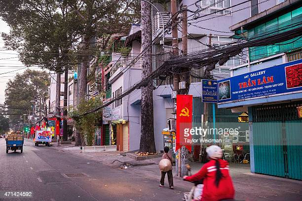 Vietnamese men and women travel through the city on April 22 2015 in Ho Chi Minh City Vietnam April 30th marks the 40th anniversary of the capture of...