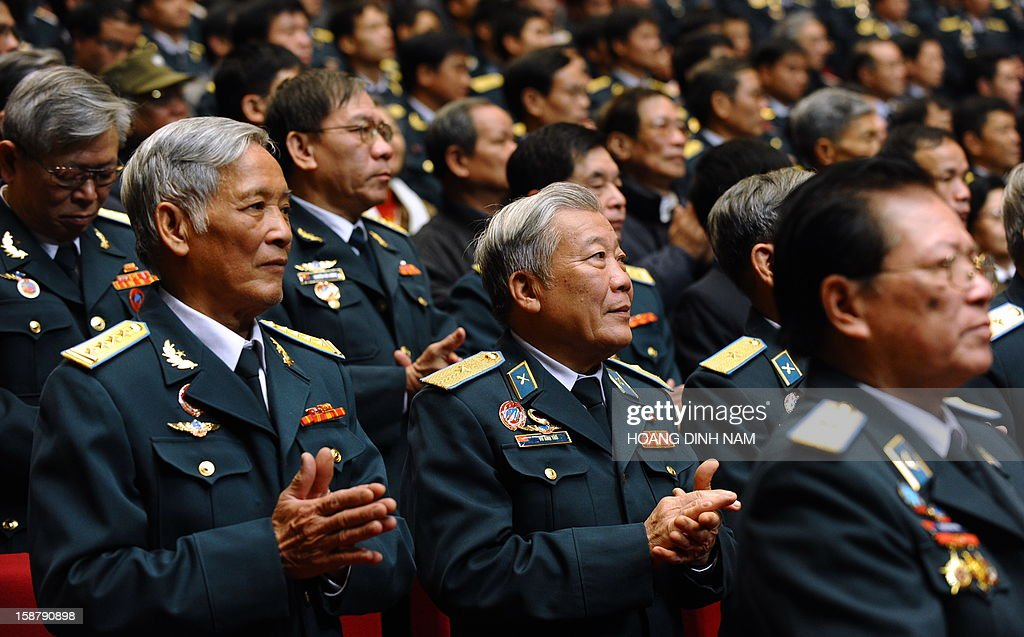 Vietnamese military personnel attend a ceremony marking the 40th anniversary of 'Dien Bien Phu in the air' or victory over US Airforce B-52's Christmas bombing, in Hanoi on December 29, 2012. Hanoi claimed downing some 34 US B-52 aircrafts during the 12-day US bombing campaign in December 1972 over Hanoi and neighbouring provinces. The meeting is the final event of a month-long celebration organised by the government. AFP PHOTO/HOANG DINH Nam