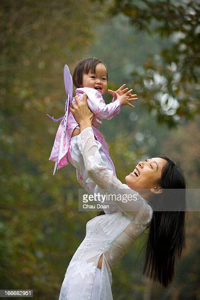 Vietnamese mother and young child in traditional attire RELEASED