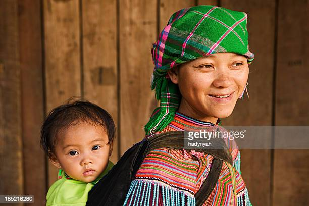 Vietnamese mother from Flower Hmong Tribe with her baby