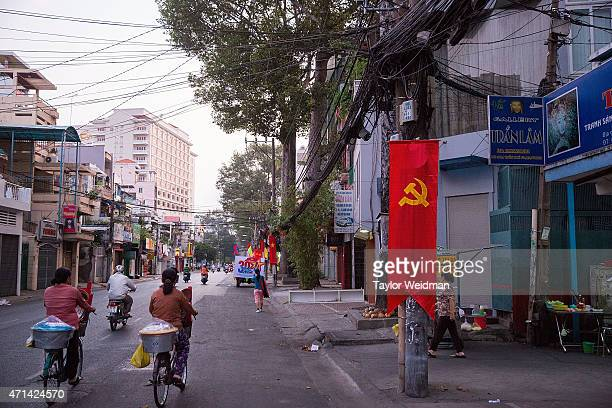 Vietnamese motorcyclists ride through the city on April 22 2015 in Ho Chi Minh City Vietnam April 30th marks the 40th anniversary of the capture of...