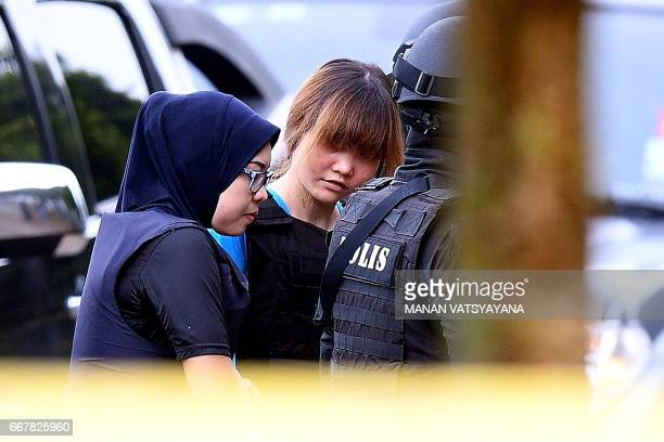 Vietnamese national Doan Thi Huong is escorted by Malaysian police for a court appearance with Indonesian national Siti Aisyah at the magistrates'...