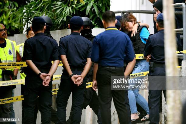 Vietnamese national Doan Thi Huong is escorted by Malaysian police after a court appearance with Indonesian national Siti Aisyah at the magistrates'...