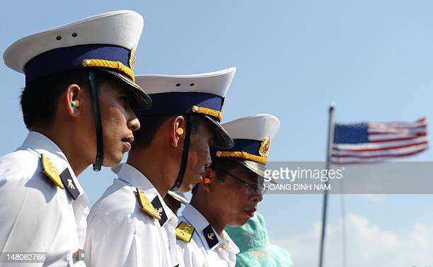 Vietnamese navy's officers observe US sailors demonstrating their skills aboard the guided missile destroyer USS Chafee during a disaster control...