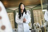 Vietnamese optometrist smiling in office