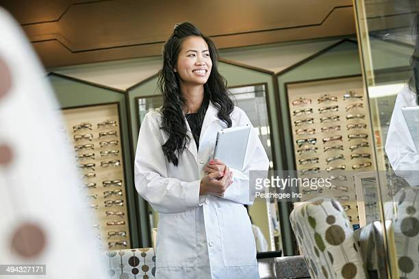 Vietnamese optometrist smiling in office