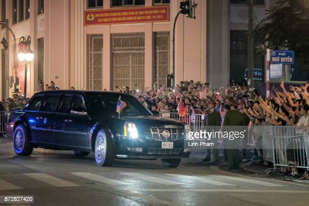 Vietnamese people gather in front of Hanoi Opera House as the convoy transporting US President Donald Trump passes by on November 11 2017 in Hanoi...