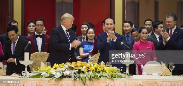 Vietnamese President Tran Dai Quang and US President Donald Trump attend a state dinner in Hanoi on November 11 2017 Trump arrived in the Vietnamese...