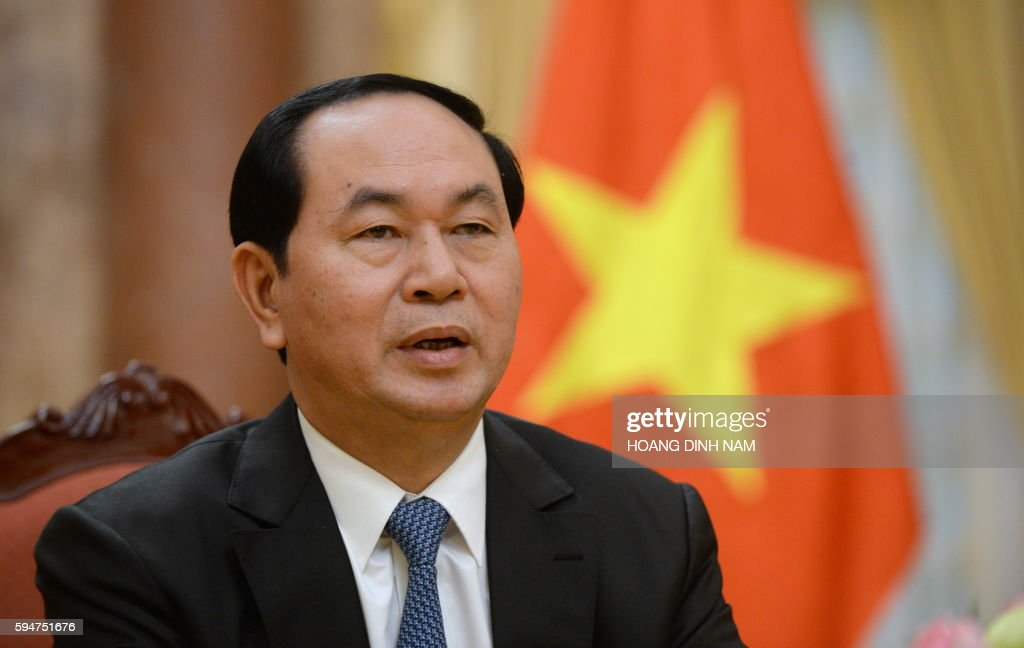 Vietnamese president Tran Dai Quang speaks during an interview with AFP at the presidential palace in Hanoi on August 24 2016 France and other...