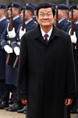 Vietnamese President Truong Tan Sang attends a military welcome ceremony at Bellevue Presidential Palace on November 25 2015 in Berlin Germany Sang's...