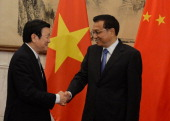 Vietnamese President Truong Tan Sang meets the Chinese Premier Li Keqiang at the Diaoyutai State Guest House on June 20 2013 in Beijing China The...