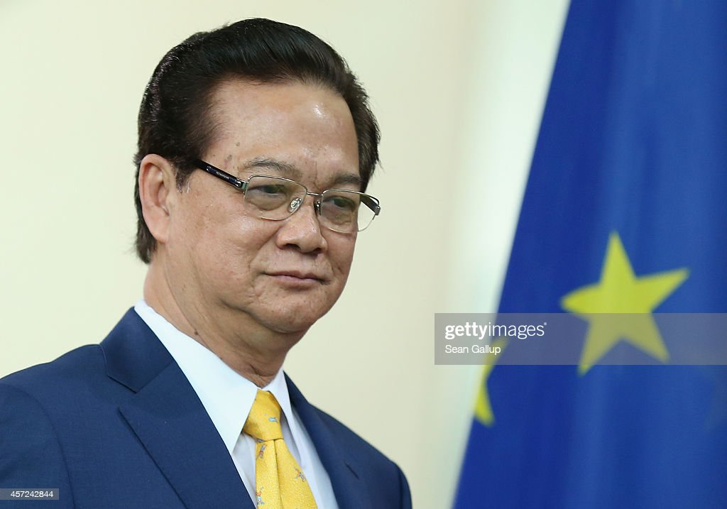 Vietnamese Prime Minister <a gi-track='captionPersonalityLinkClicked' href=/galleries/search?phrase=Nguyen+Tan+Dung&family=editorial&specificpeople=544511 ng-click='$event.stopPropagation()'>Nguyen Tan Dung</a> and German Chancellor Angela Merkel (not pictured) arrive to speak to the media following talks at the Chancellery on October 15, 2014 in Berlin, Germany. The two leaders discussed, among other topics, the current tensions between China, Vietnam and the Philippines over access to the South China Sea sea lanes.