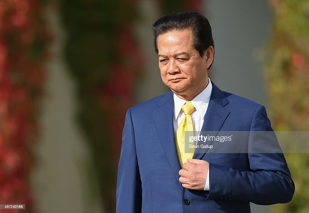 Vietnamese Prime Minister <a gi-track='captionPersonalityLinkClicked' href=/galleries/search?phrase=Nguyen+Tan+Dung&family=editorial&specificpeople=544511 ng-click='$event.stopPropagation()'>Nguyen Tan Dung</a> arrives for talks with German Chancellor Angela Merkel at the Chancellery on October 15, 2014 in Berlin, Germany. Prime Minister Nguyen is on a two-day visit to Germany that started yesterday with his arrival in Stuttgart.