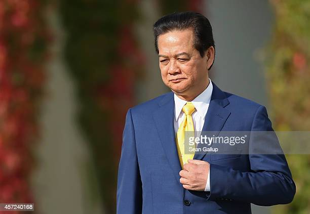Vietnamese Prime Minister Nguyen Tan Dung arrives for talks with German Chancellor Angela Merkel at the Chancellery on October 15 2014 in Berlin...