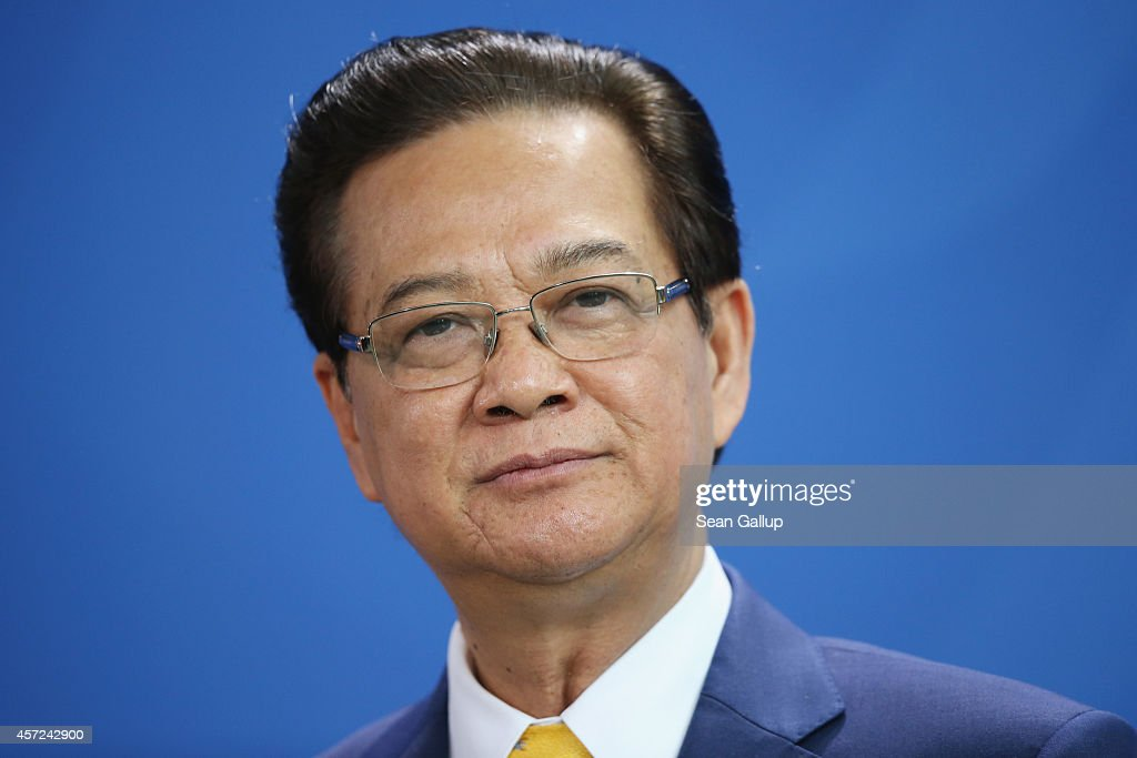 Vietnamese Prime Minister <a gi-track='captionPersonalityLinkClicked' href=/galleries/search?phrase=Nguyen+Tan+Dung&family=editorial&specificpeople=544511 ng-click='$event.stopPropagation()'>Nguyen Tan Dung</a> speaks to the media with German Chancellor Angela Merkel (not pictured) following talks at the Chancellery on October 15, 2014 in Berlin, Germany. The two leaders discussed, among other topics, the current tensions between China, Vietnam and the Philippines over access to the South China Sea sea lanes.