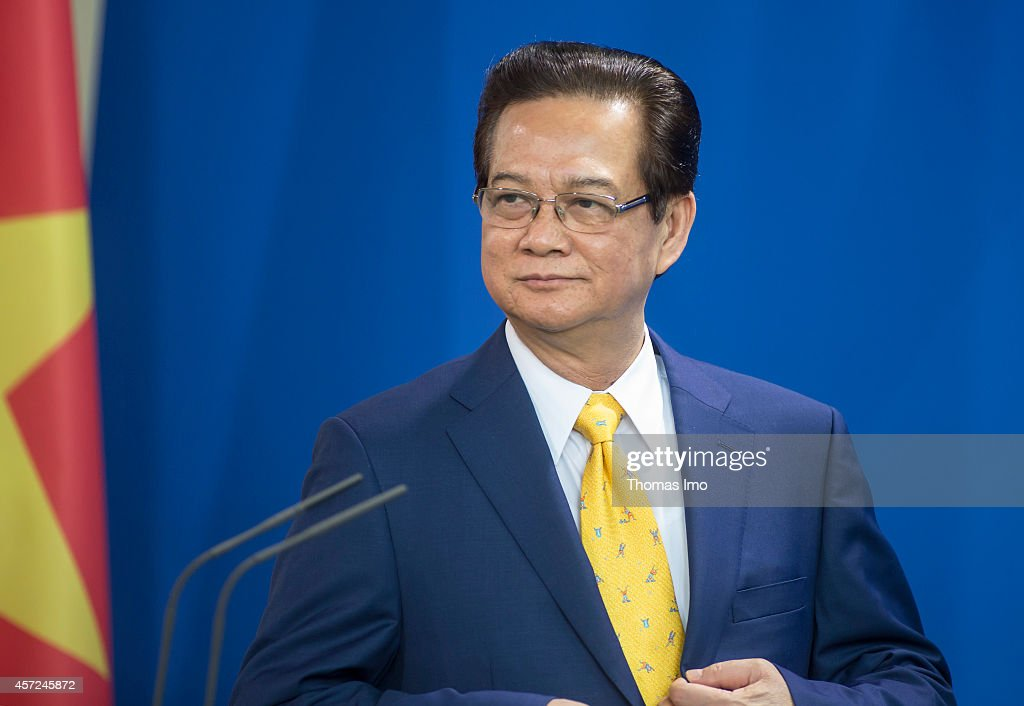 Vietnamese Prime Minister <a gi-track='captionPersonalityLinkClicked' href=/galleries/search?phrase=Nguyen+Tan+Dung&family=editorial&specificpeople=544511 ng-click='$event.stopPropagation()'>Nguyen Tan Dung</a> speaks to the media with German Chancellor Angela Merkel (not pictured) following talks at the Chancellery on October 15, 2014 in Berlin, Germany. The Vietnamese PM is on a week-long visit to Europe.