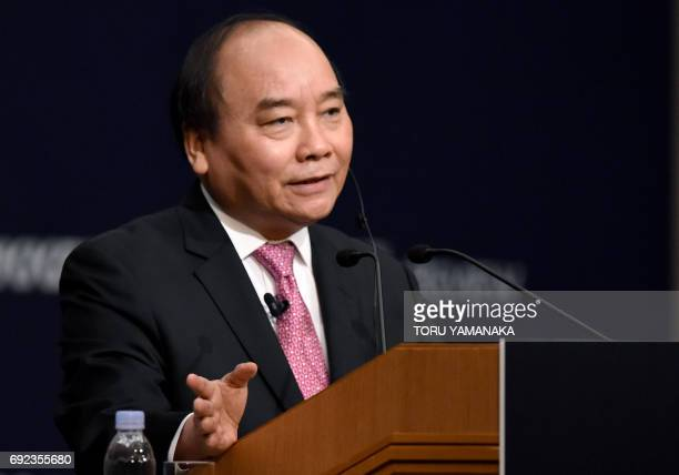 Vietnamese Prime Minister Nguyen Xuan Phuc answers questions during an international conference in Tokyo on June 5 2017 Nguyen is on an official...