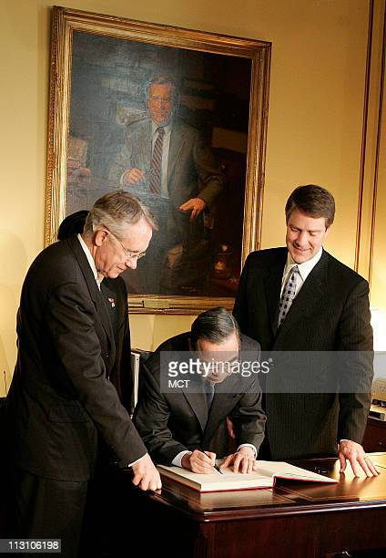 WASHINGTON DC Vietnamese Prime Minister Phan Van Khai center signs a guest book in the office of Senate Majority Leader Bill Frist right and is...