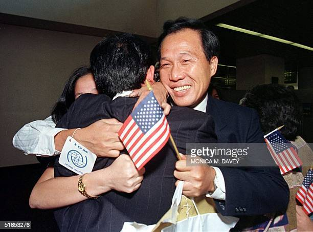 Vietnamese refugee Tran Di Thuong is welcomed by his brother Tran Truong after arriving at San Francisco airport from Hong Kong as a new immigrant to...