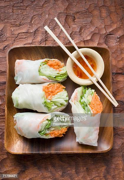 Vietnamese rice paper rolls with dip and chopsticks