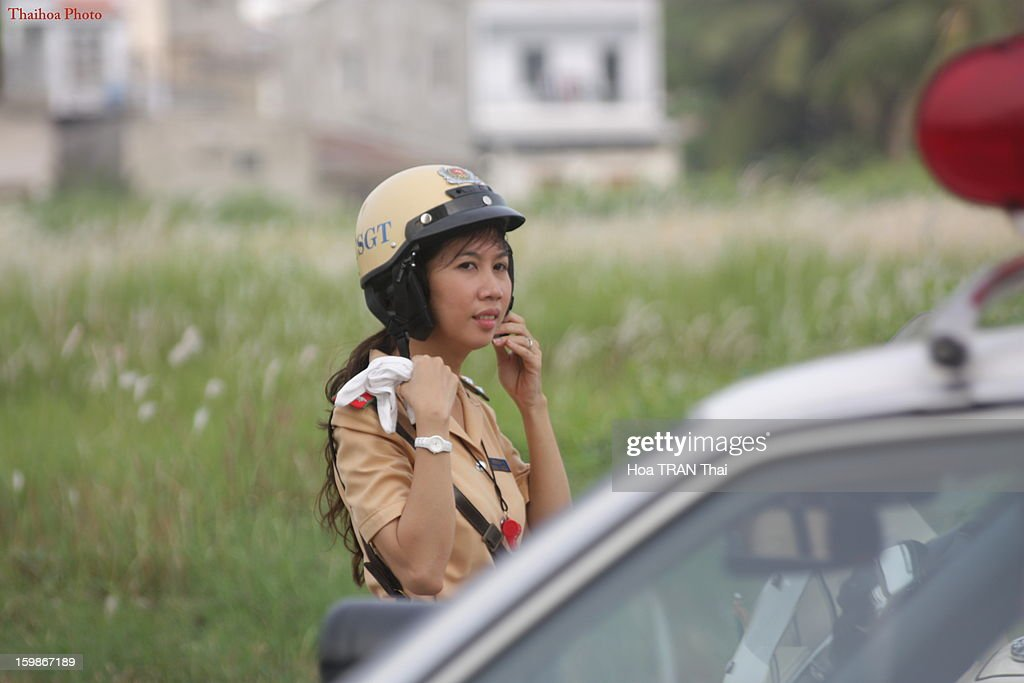 CONTENT] Vietnamese traffic police. Location: Ho Chi Minh City