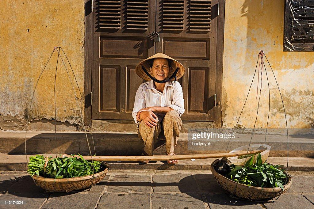 Vietnamese vegetable seller : Stock Photo