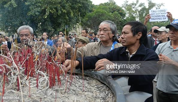 Vietnamese veterans place incense sticks during a small rally marking the 38th anniversary of the Chinese war border against Vietnam in front the...