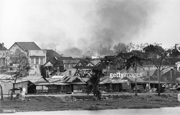 A Vietnamese village burning on the banks of the Perfume River