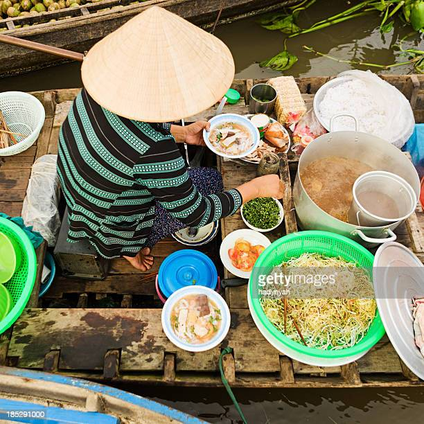 Vietnamese woman selling  Pho - noodle soup on floating market