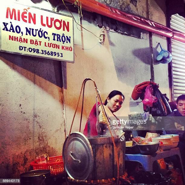 Vietnamese woman serving pho in Hanoi Vietnam Street food