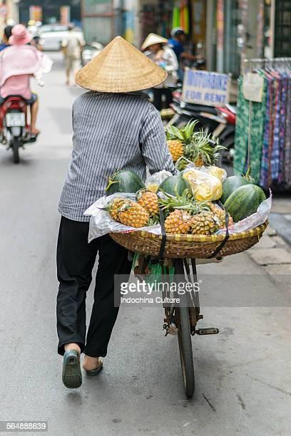 Vietnamese woman street vendor, Hanoi, Vietnam