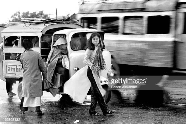 vietnamese-women-board-a-threewheeled-ta