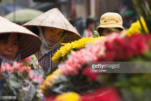 Vietnamese women flower vendors at the Cho Dong Xuan market in central Hanoi