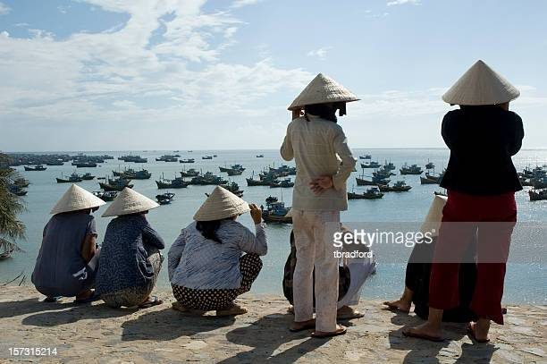Vietnamese Women Looking Out To Sea In Mui Ne