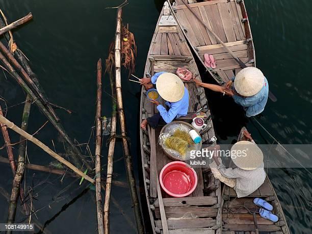 Vietnamese women relaxing during lunch break  in Hoi An, Vietnam