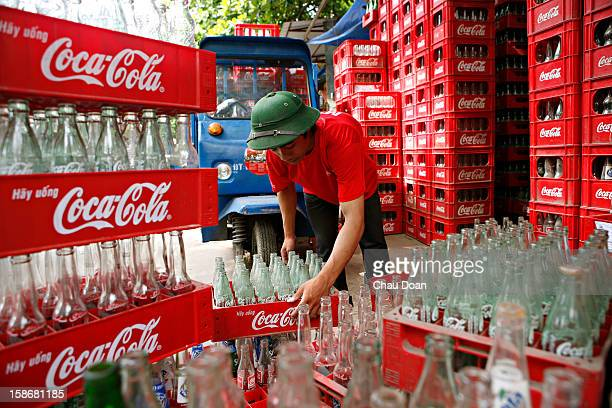 Vietnamese worker arranges empty Coca Cola bottles at a recyling center in Son Dong village about 14 kms northwest of Hanoi