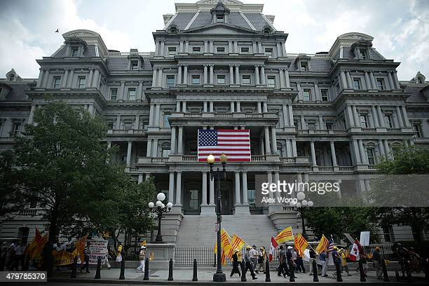 VietnameseAmerican activists march outside Eisenhower Executive Office Building of the White House as US President Barack Obama meets with General...