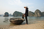 Vietnam,Halong Bay,Woman with Boat.