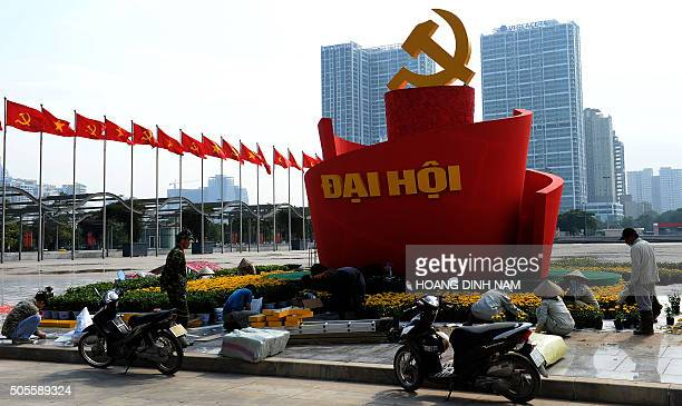 VietnampoliticsFOCUS by Cat Barton This picture taken on January 18 2016 shows workers setting up decorations in front of the My Dinh National...