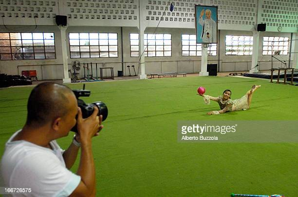 Vietnam's best known fashion photographer Hai Dong during a photo shoot inside a gym The chosen model is Minh Tam one of Vietnam's medal winning...