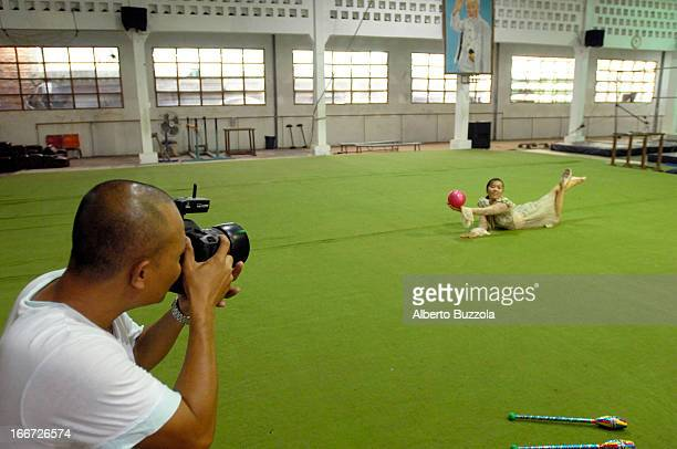 Vietnam's bestknown fashion photographer Hai Dong during a photo shoot inside a gym The model is Minh Tam an acrobat winner of gold medals in...