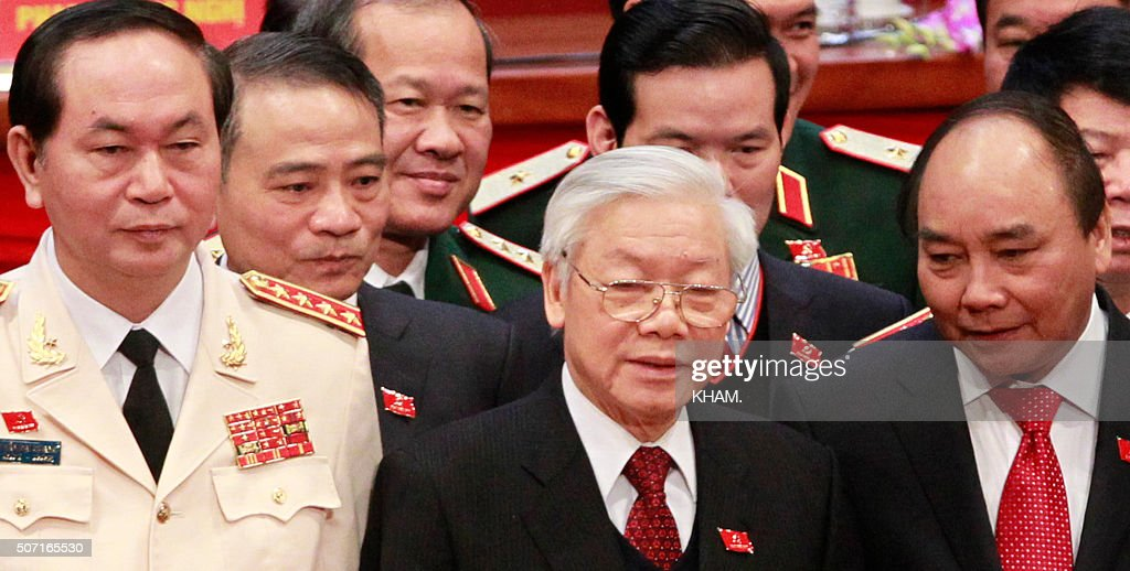 Vietnam's Communist Party General Secretary Nguyen Phu Trong stands next to Deputy Prime Minister Nguyen Xuan Phuc and Public Security Minister Tran...