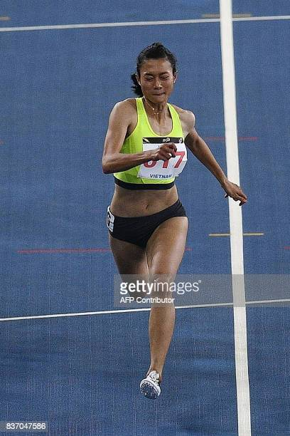 Vietnam's Le Tu Chinh competes during the women's 100m athletics final of the 29th Southeast Asian Games at the Bukit Jalil national stadium in Kuala...