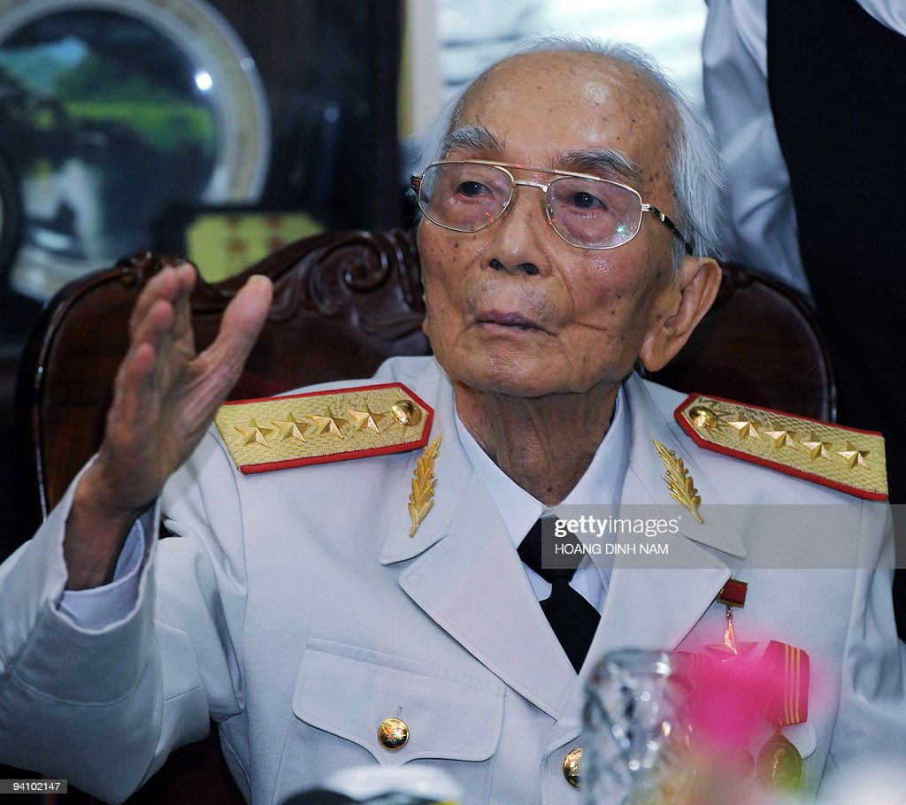 Vietnam's legendary general Vo Nguyen Giap waves to visitors at the end of a visit by Brazilian President <a gi-track='captionPersonalityLinkClicked' href=/galleries/search?phrase=Luiz+Inacio+Lula+da+Silva&family=editorial&specificpeople=211609 ng-click='$event.stopPropagation()'>Luiz Inacio Lula da Silva</a> at his home in Hanoi on July 10, 2008. Lula praised Vietnam's war-time success against the United States as a 'victory of the oppressed' on a visit to the communist country. AFP PHOTO/HOANG DINH Nam