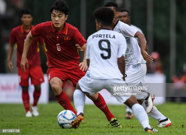 Vietnam's Luong Xuan Truong controls the ball against East Timor players during their men's football Group B round match at the 29th Southeast Asian...