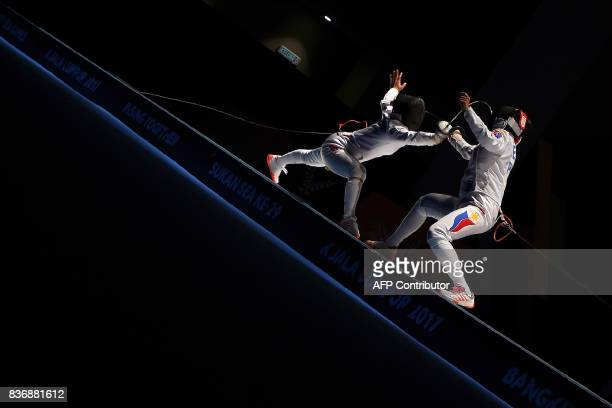 Vietnam's Nguyen Thi Nhu Hoa competes with Abella Hanniel of the Philippines in the women's fencing epee individual final of the 29th Southeast Asian...