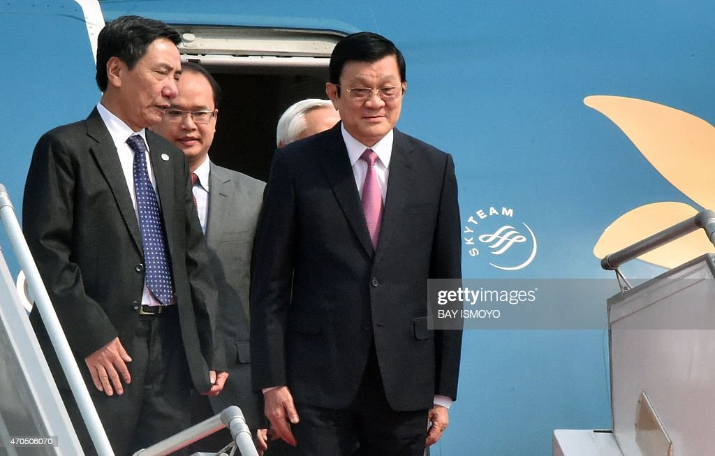 Vietnam's President Truong Tan Sang (R) disembarks from an aircraft after arriving at Halim airport in Jakarta on April 21, 2015 ahead of the opening of the Asian-African Conference. Asian and African leaders gather in Indonesia this week to mark 60 years since a landmark conference that helped forge a common identity among emerging states, but analysts say big-power rivalries will overshadow proclamations of solidarity.
