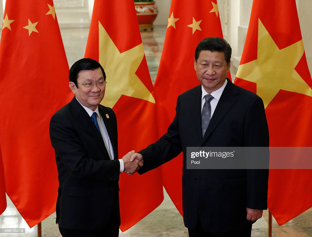 Vietnam's President Truong Tan Sang shakes hands with China's President Xi Jinping (R), during a meeting at the Great Hall of the People, on the sidelines of the Asia Pacific Economic Cooperation (APEC) meetings, November 10, 2014 in Beijing, China. APEC Economic Leaders' Meetings and APEC summit is being held at Beijing's outskirt Yanqi Lake.
